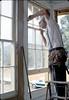 Ralph Moore installing windows, 9/1982. acc2005.001.0308
