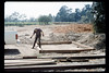 Gene Allen lays out wooden foundation for miniature-train shed, 5/1990. acc2005.001.1338