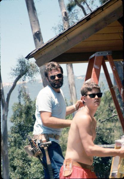 M&M Construction installs new redwood gutters, 5/1988. acc2005.001.0958