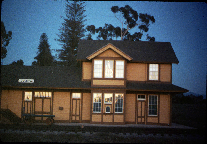 Goleta Depot front exterior with Christmas tree in upstairs bay, 12/1988. acc2005.001.1030