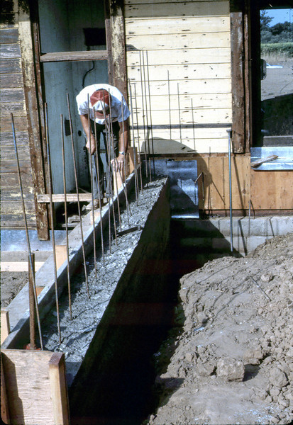 Ralph Moore works on foundation for new freight dock, 8/1982. acc2005.001.0295