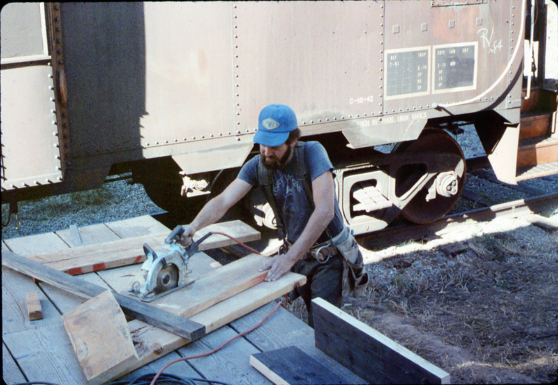 Steve Moore works on caboose walkway construction, 10.1986. acc2005.001.0646