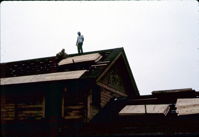 Installing plywood for new roof, 6/1982. acc2005.001.0247