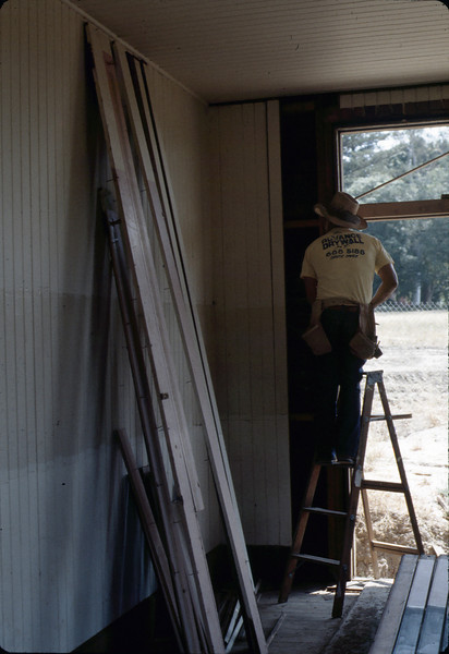 """Louie"" removing paneling in Waiting Room to add shear wall, 6/1982. acc2005.001.0221"