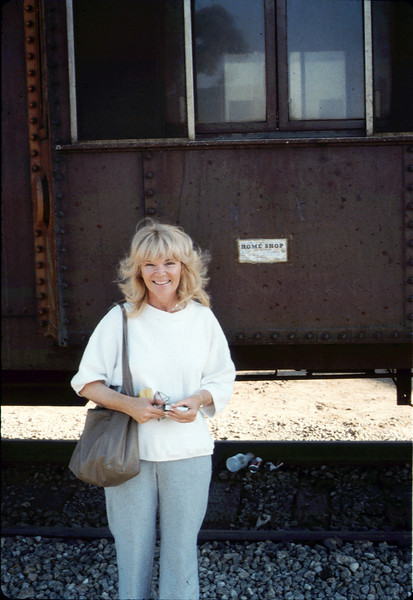 Phyllis Olsen poses with Caboose 4023 at La Patera, 9/21/1986 acc2005.001.0610
