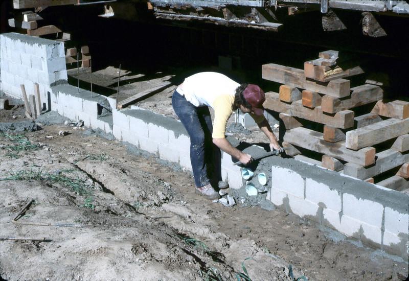 Finishing foundation work, Feb. 1982.