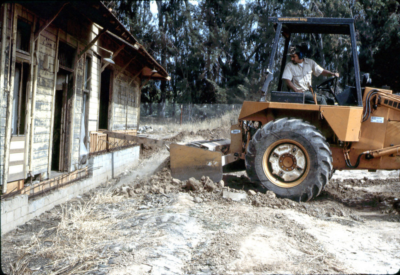 County worker backfills foundation, 6/1982. acc2005.001.0258