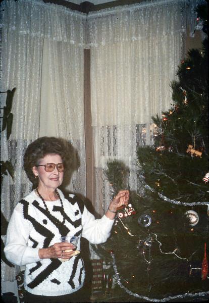 Helen Coffey helps decorate the Goleta Depot Christmas tree, 12/1987. acc2005.001.0884