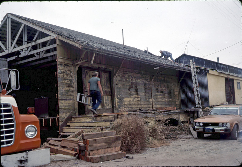 Separating small section of depot from attached shed, 11/16/1981.. acc2005.001.0057