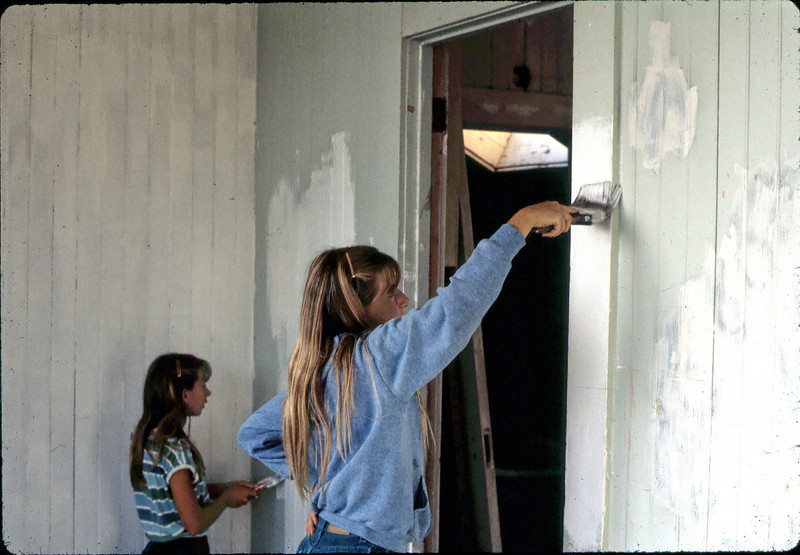 Stephanie Coombs, left, and Heather Coombs prep an upstairs room for painting, 7 or 8/1982. acc2005.001.0272