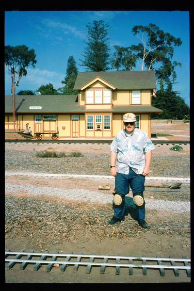 Jack Cogan works on miniature-train expansion which will add 600 feet to route, Summer 1994. acc2005.001.2014