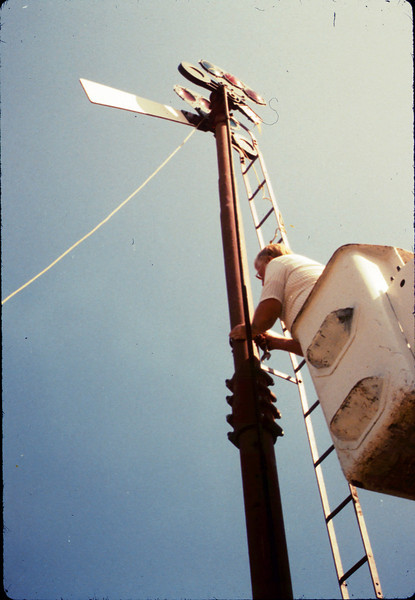 Bill Battisone, OK Tree Service, installs ladder on train-order pole, Work Day, 4/9/1988. acc2005.001.0925
