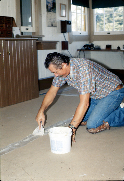 John Morelli applies new flooring in Freight Office, 9/1983. acc2005.001.0411