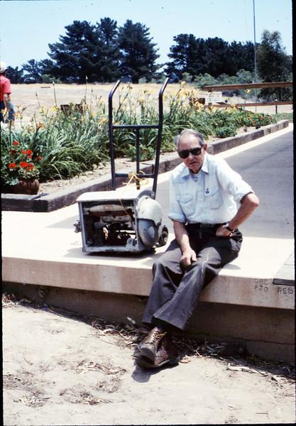 Gene Allen with wig-wag signal mechanism, 5/1989. acc2005.001.1169