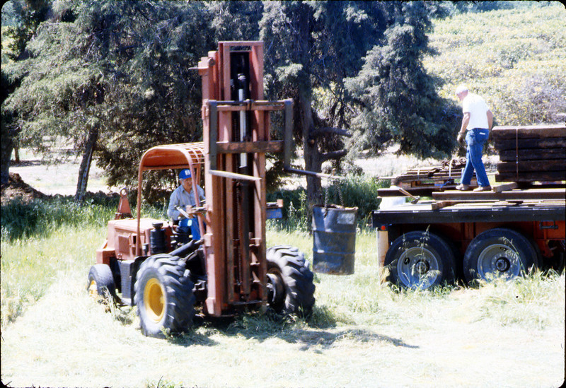 Laying of the standard-gauge track (Ed Lebeck on forklift), 4/2/1985 acc2005.001.0480G