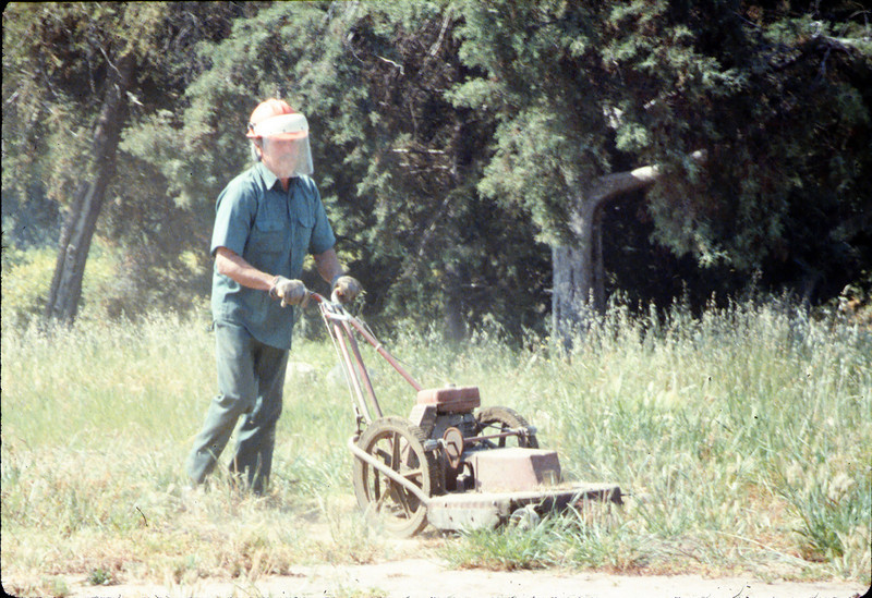 Al Jaramillo cutting weeds, Spring 1987. acc2005.001.0762
