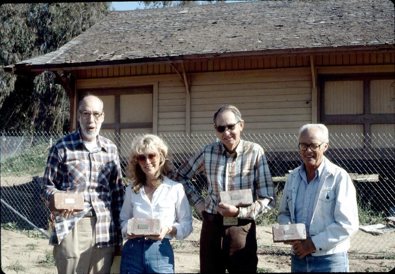 Depot bricks: Ray Baird, Phyllis Olsen, Gene Allen, George Adams, Feb. 1982. acc2005.001.0143