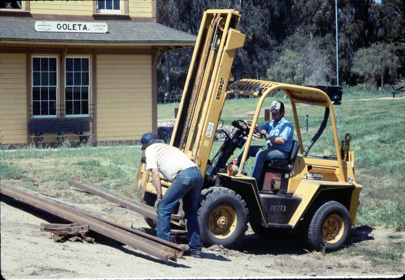 Track materials from Sears Spur are delivered to museum by John Basquez, 4/1987. acc2005.001.0736
