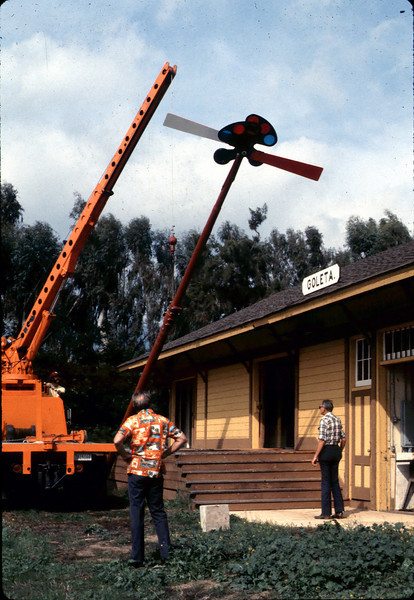 Specialty Crane & Rigging truck raises train-order pole for re-installation (Bill Everett, left, and Gene Allen are watching), 10/1983. acc2005.001.0426