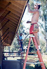 M&M Construction installs new redwood gutters, 5/1988. acc2005.001.0964