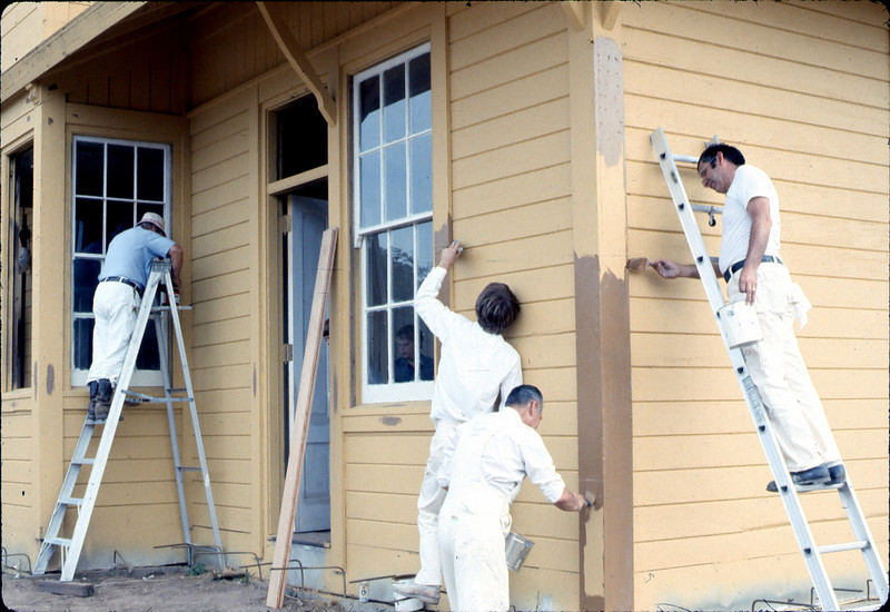 Painter's Union men return to apply trim. Also, Bob Hiestand, 9/1982.. acc2005.001.0317