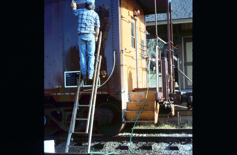 Ron Robinson cleans Caboose 4023, 12/1986 acc2005.001.0663