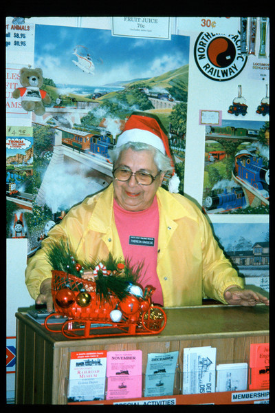 """The """"Holiday Train"""" event, which later became the """"Candy Cane Train,"""" was first held in 1993, from Nov. 26 thru Dec. 24. This is Shop Clerk Theresa Caccese. acc2005.001.1896"""