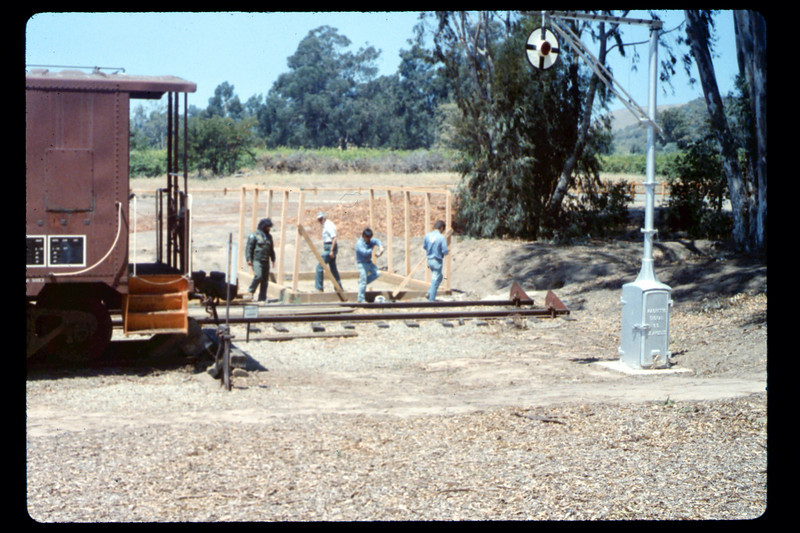 Gene Allen and crew prepares framing for miniature-train shed, 6/1990. acc2005.001.1340