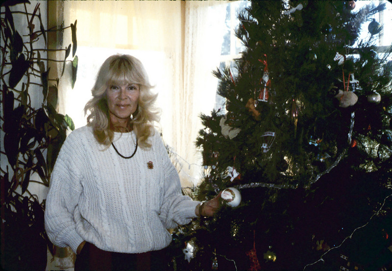 Assistant Director Phyllis Olsen and Goleta Depot Christmas tree, 12/1987. acc2005.001.0903