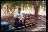 "John Locke helps decorate ""El Tren de la Fiesta,"" Aug. 6, 1994. acc2005.001.1989"