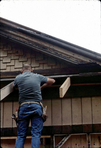 "Carpenter ""Paul"" rebuilding eave, 6/1982. acc2005.001.0227"