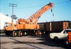 Specialty Crane & Rigging prepares to raise the caboose body onto an awaiting trailer, 9/25/1986 acc2005.001.0614