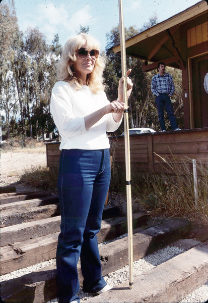 Laying of the standard-gauge track (Phyllis Olsen holds stadia rod), 5/11/1985. acc2005.001.0494