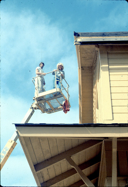 Painter's Union men return to apply trim. Also, Phyllis Olsen, 9/1982. acc2005.001.0311