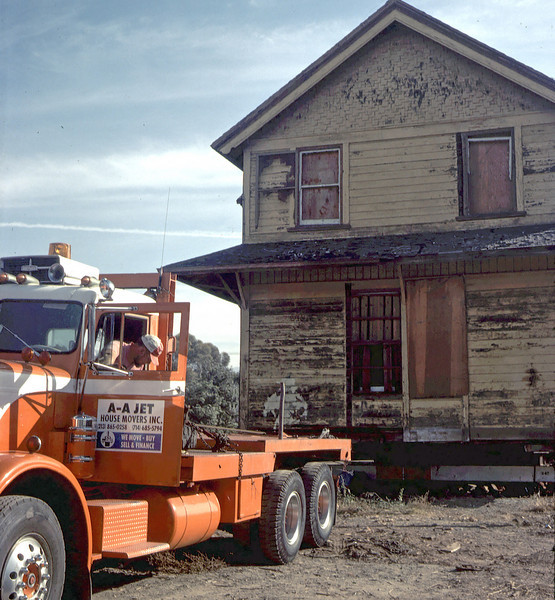 """""""Oakie"""" pulling two-story section of building away from foundation, 11/12/1981. acc2005.001.0030"""
