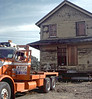 """Oakie"" pulling two-story section of building away from foundation, 11/12/1981. acc2005.001.0030"