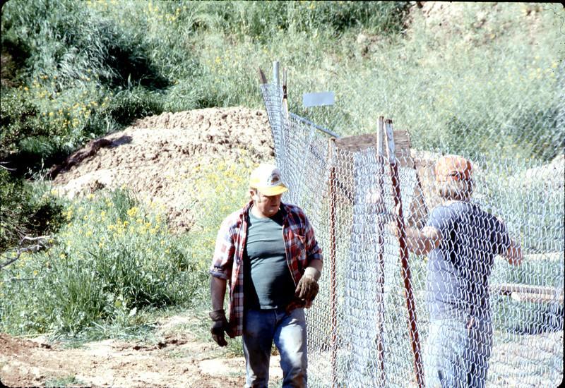 Repairing fencing, 3/2/1982. acc2005.001.0186