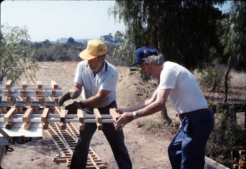 Gene Boswell and Malcolm Alexander help with the miniature-railroad track construction, 6/1987 acc2005.001.0810