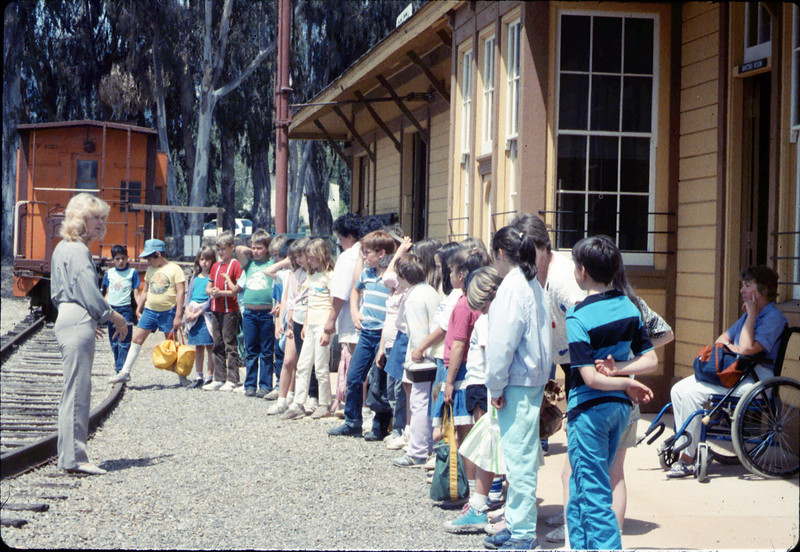 Phyllis Olsen leads a tour for La Patera Elementary School classes, 4/15/1987. acc2005.001.0743