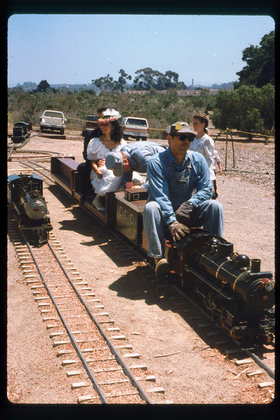 Wedding party rides the miniature train during Steaming Summer, 1991. acc2005.001.1479