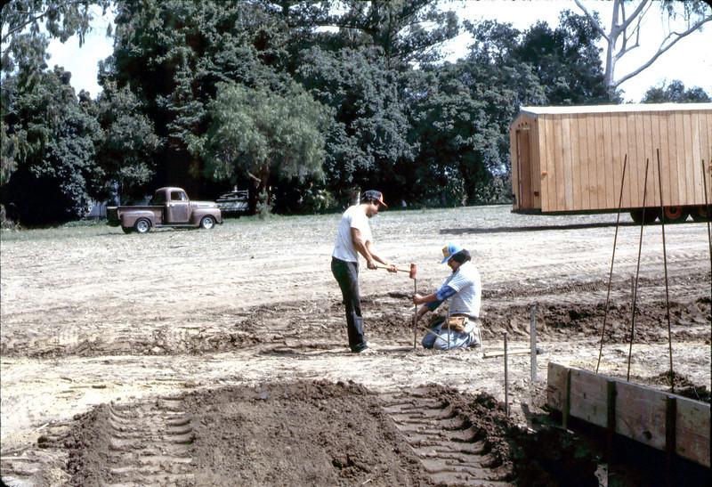 Sidewalk work, 9/1982 or early 10/1982. acc2005.001.0337