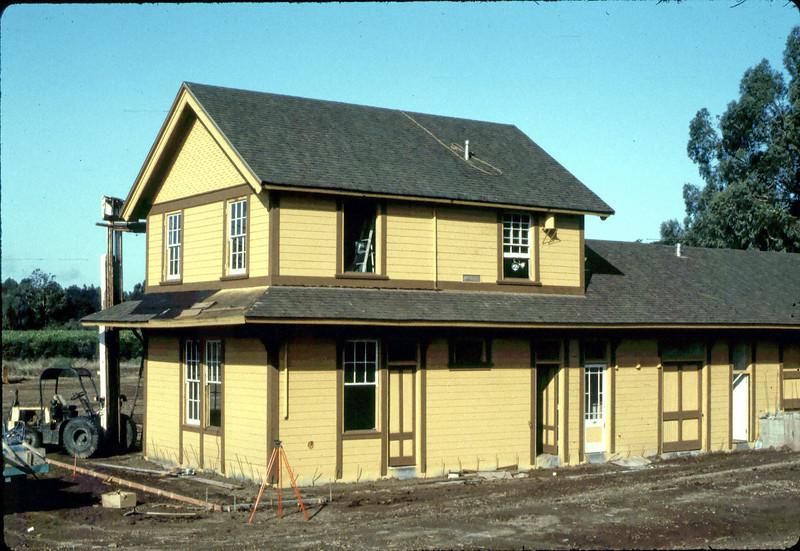 Survey work for sidewalk installation, 9/1982. acc2005.001.0332
