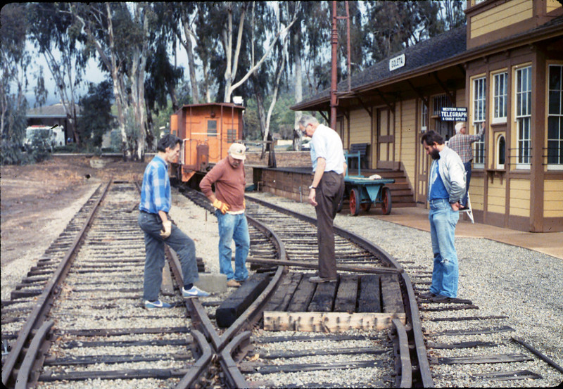 Work Day (Gene Allen, Dave Hieter & others building handcar boarding platform), 1/1990. acc2005.001.1241