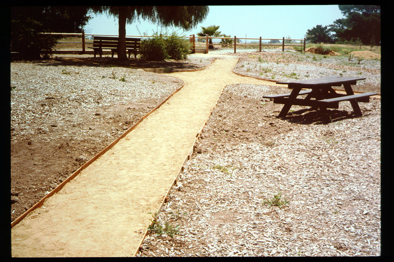 Two new paths, including one that is wheelchair-accessible, were built in 1994 from the sidewalk to the eastern portion of the museum grounds, including the train-ride boarding area. Volunteers who worked on the project were Gene Allen, Al Jaramillo, and Bill Parker. acc2005.001.1936