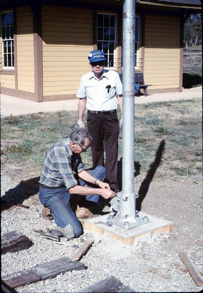 Gene Allen and Glen Apers install train-order post, 2/1987. acc2005.001.0692