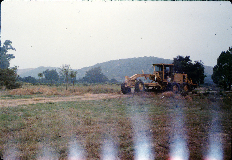 Banner Construction grades right-of-way for miniature-train track, 10/1986. acc2005.001.0640