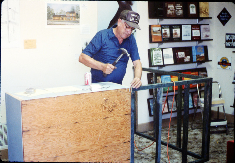 Elmer Coombs builds a sales counter for the Trackside Shop museum store, 10/1988. acc2005.001.1014