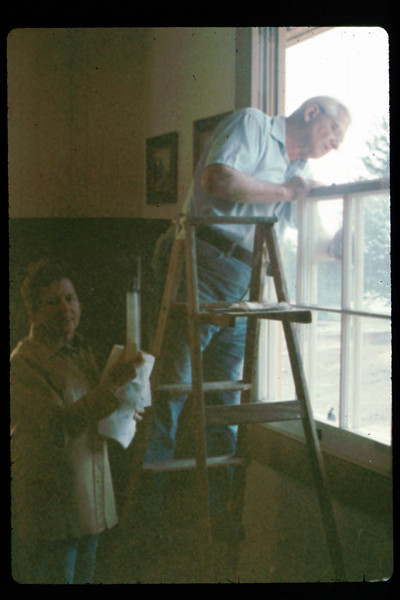 Hilda Volkman and Paul Conover wash windows, 2/1991. acc2005.001.1451