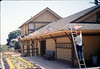 Ed Lebeck decorates Goleta Depot with flags for Fourth of July, 7/4/1987. acc2005.001.0817