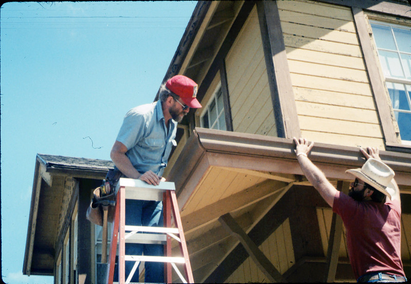 M&M Construction installs new redwood gutters, 5/1988. acc2005.001.0969